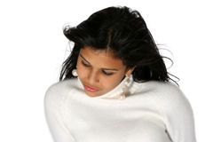 Beautiful young woman. Portrait of attractive young woman in white turtleneck sweater looking down pensively Royalty Free Stock Photo