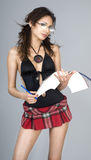Beautiful young woman. Wearing cute  plaid mini skirt Royalty Free Stock Photos