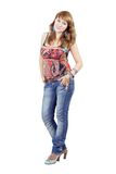 The beautiful young woman. In blue jeans. Isolated Stock Image