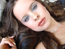 Beautiful young woman. With green eyes stares Royalty Free Stock Photos
