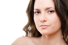 Beautiful young woman. With dark hair and bare shoulders, white studio background Royalty Free Stock Photography