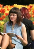 Beautiful young woman. Reading a book with her friend Royalty Free Stock Images