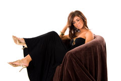Beautiful young woman. Sitting on a sofa Royalty Free Stock Photography