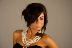 Beautiful young woman. With a pearl necklace Stock Image