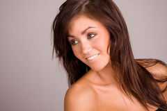 Beautiful young woman. Beautiful young brunette woman smiling Royalty Free Stock Images