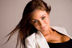 Beautiful young woman. Beautiful young brunette woman with wind in her hair Royalty Free Stock Photo