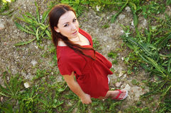 Beautiful young woman from above. Young beautiful woman in red from above Stock Image