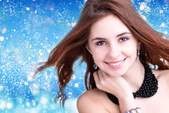 Beautiful young woman  on abstract blue background Royalty Free Stock Photo