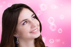 Beautiful young Woman. On a abstract pink background Stock Images