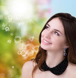 Beautiful young Woman. On abstract sunlight summer nature background Royalty Free Stock Images