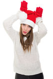Beautiful young woman acting like a reindeer Stock Images