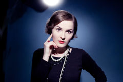 Beautiful young woman actress posing. Chanel style Stock Photo