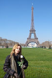 Beautiful young woman against Tour d'Eiffel. France, Paris. Stock Photo
