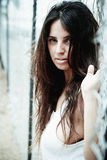 Beautiful young woman agianst fence Royalty Free Stock Images