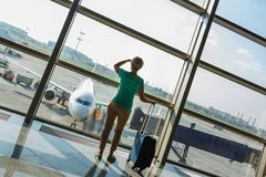 Beautiful young woman at the airport Stock Images