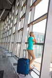 Beautiful young woman at the airport Royalty Free Stock Photography