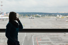 Beautiful young woman at the airport Stock Photography