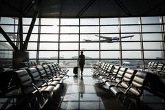 Beautiful young woman at the airport Stock Image