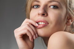 Beautiful young woman with alluring glance stock photo