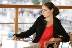 Beautiful Young Woman Alone In Street Cafe Stock Photo