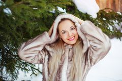 Woman in winter park Stock Photo