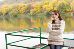 Beautiful young woman alongside a river Royalty Free Stock Photography