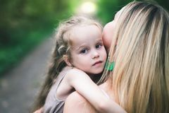 Beautiful Young Woman And Her Charming Little Daughter Are Hugging Stock Photo