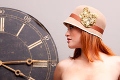 Beautiful young woman with antique clock Stock Photos