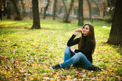 Beautiful young woman with apple Stock Photography
