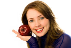 Beautiful young woman with an apple Stock Image