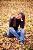 Beautiful young woman with apple in autumn park Stock Photos