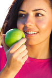 Beautiful young woman with apple  outdoor Royalty Free Stock Photos