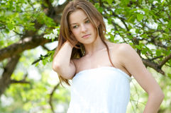 Beautiful young woman in apple tree garden Stock Photo