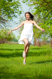 Beautiful young woman in apple tree garden Stock Images