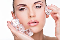 Beautiful young woman applies the ice to face Royalty Free Stock Photos