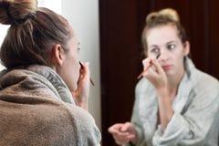 Beautiful young woman apply makeup Royalty Free Stock Photos