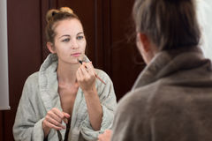 Beautiful young woman apply makeup Royalty Free Stock Photography
