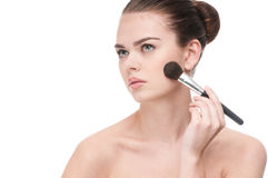 Beautiful young woman applying brush Stock Photography