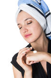 Beautiful young woman applying cleaning cream Stock Image