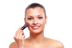 Beautiful young woman applying cosmetic Royalty Free Stock Photo