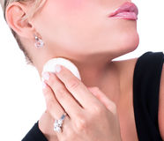 Beautiful young woman applying foundation on neck stock photos