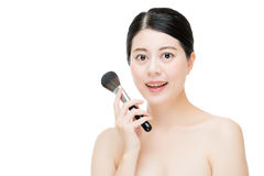 Beautiful young woman applying foundation powder blush with make Stock Image