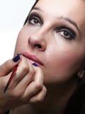 Beautiful young woman applying lips make-up zone Stock Photos