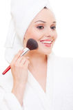Beautiful young woman applying make-up Royalty Free Stock Photography