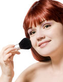 Beautiful young woman applying make-up Royalty Free Stock Image