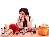 Beautiful young woman applying makeup on eye Stock Image