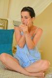 Beautiful young woman applying makeup royalty free stock image