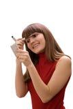 Beautiful young woman applying mascara Royalty Free Stock Photography