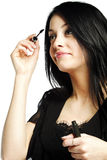 Beautiful young woman applying mascara Royalty Free Stock Photo