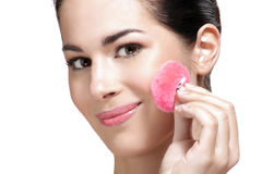 Beautiful young woman applying powder foundation Stock Photo